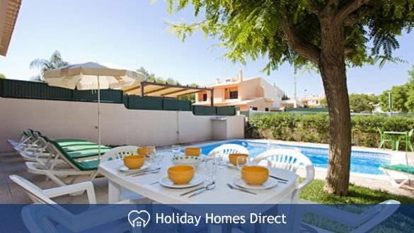 Villa Andrea outdoor dining area  and sunbeds