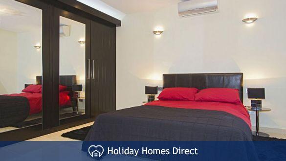 Villa insignia spare bedroom and tv in Lanzarote