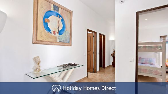Villa Bella indoor hallway and artwork