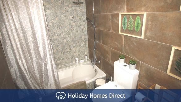 Bathroom with sunken bath & shower