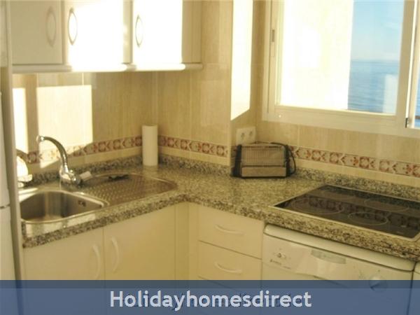 kitchen with dishwasher, washing machine etc