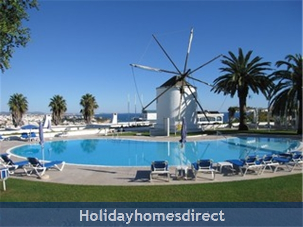 Windmill Hill, Albufeira, Algarve, Portugal: pool area with original windmill
