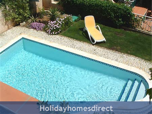 Private pool and sunbathing area