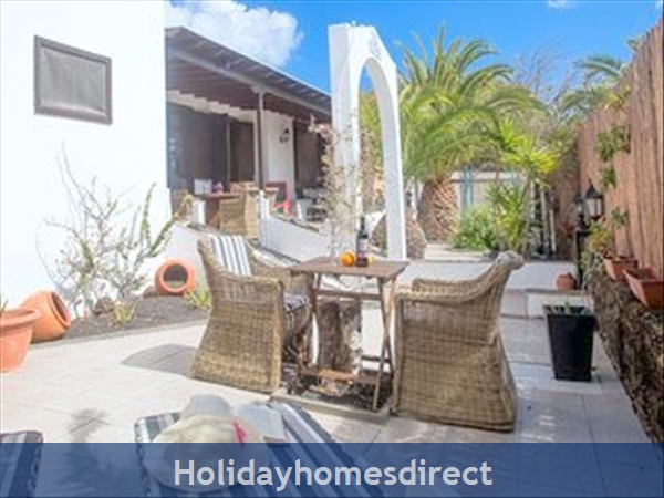 Villa Victoria -  4 Bed /3 Bath Villa + Heated Gated Pool + Play Area We Take Credit Cards: Side garden   shaded front patio