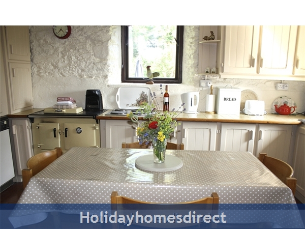 Granary Cottage .. Lots Of Character, Peace And Quiet And All The Mod Cons !: Dining table and kitchen in Granary Cottage