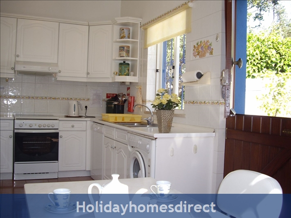 Casa Romantica Near Albufeira With Private Heatable Pool And Free Wireless Internet: Kitchen and outside door to BBQ
