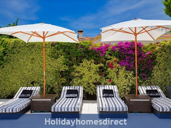 Palm Villa Tots Safe Villa In El Paraiso Visa Accepted + 4 Bed+ 3 Bath+ Play Area+ Heated Pool + Paddle Pool- Close To All Amenties No Car Needed-: padded cushions to all sun beds