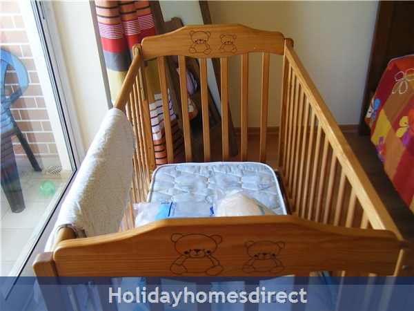 Baby cot with bedding