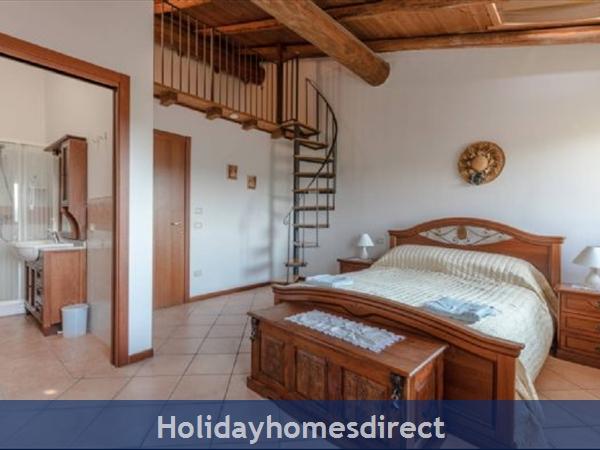 Near Lake Garda - Rustic Apartment 4a: Bedroom 1 with en-suite shower room