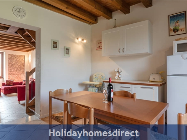 Near Lake Garda - Rustic Apartment 5a: Kitchen/diner leading through to lounge