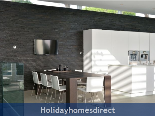 Villa Bond indoor dining area with a tv