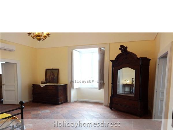 Villa Dimora Emilia - Historic '700  Apartments In Amalfi Coast: Large bedroom antique furniture in massa lubrense