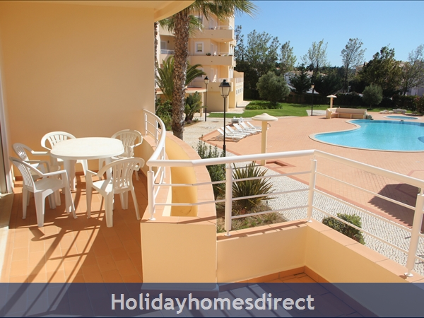 Vilas Das Acacias Apartment Bg - Praia Da Luz. Walk Everywhere Including The Beach !: Sunny veranda with pool and sea view