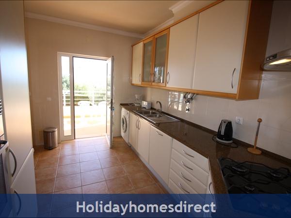 Well equipped kitchen with door to veranda