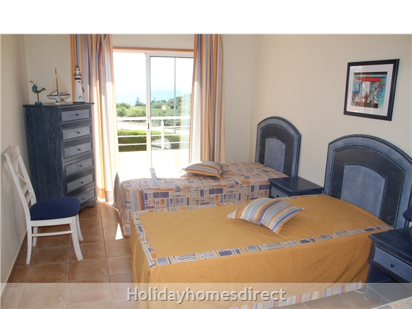 Vilas Das Acacias Apartment Bg - Praia Da Luz. Walk Everywhere Including The Beach !: Bedroom 2 has 3 single beds, veranda with sea view