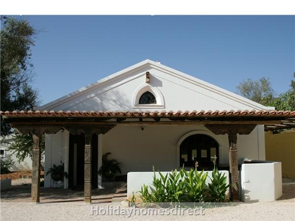The Front Entrance and Short Veranda
