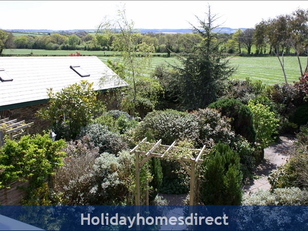 Doyle's Cottage ..  Between Waterford, Wexford And Kilkenny.. With Lots To See And Do !: Garden and countryside view from bedroom