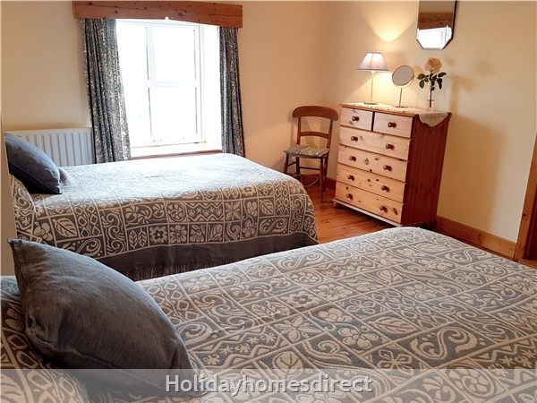 Doyle's Cottage ..  Between Waterford, Wexford And Kilkenny.. With Lots To See And Do !: Twin Bedroom has garden and country views