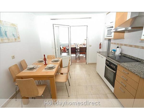 Villa Carol indoor dining area with kitchen