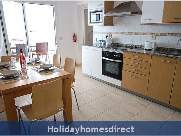 Villa Carol dining area with kitchen and terrace