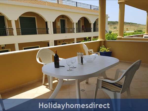 Domusiberica Apartment Fd.. In Burgau Village Walk To Everywhere Including The Beach.: Just the time for wine on the veranda!