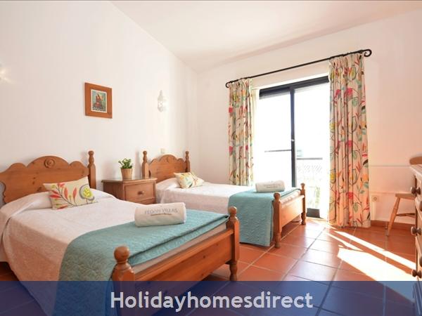 Villa Joy spare bedroom with single beds