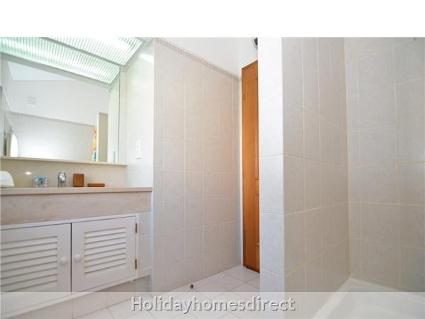 Villa Joy bathroom with shower and sink