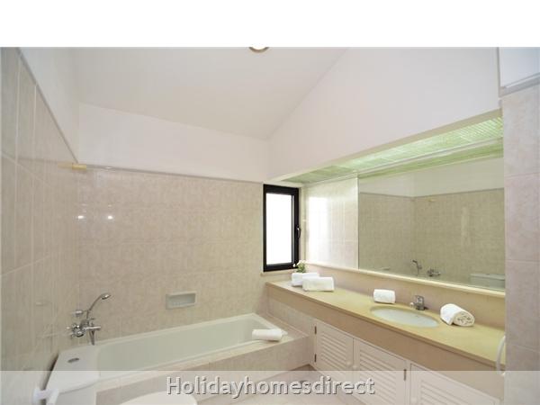Villa Joy master bathroom with a bath
