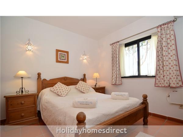 Villa Joy master bedroom with double bed