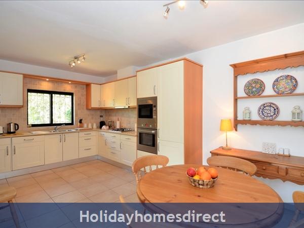 Villa Joy indoor kitchen and dining area