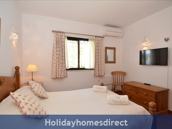Villa Joy spare bedroom with double bed and tv