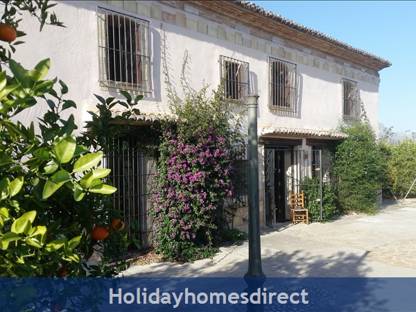 Caseta Del Dalt, Valencia. Sleeps 10. 5 Bedrooms. 4 Bathrooms. Private Parking. Private Pool. Free Wifi: View of house from parking area