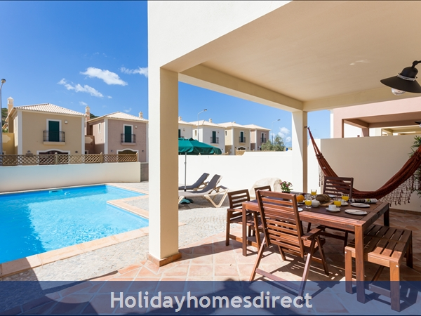 Patio furniture, private pool, walk to beach