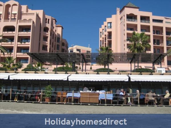 La Torre De Marbella:  we are middle building behind El Fuerte Hotel5*